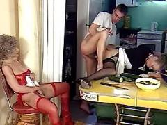 Guy fucking two grannies in kitchen