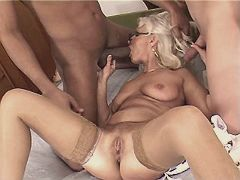 Mom sucking two big cocks