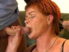 Hot busty mature smears cum on face