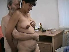 Aged woman sucks cocks in threesome