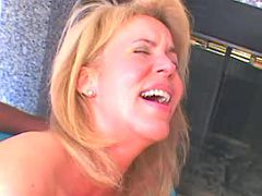 Lovely milf taking huge black stick