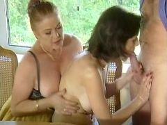 Mature and girl give blowjob to man