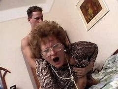 Granny fucks from behind